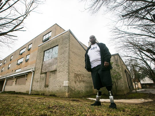 David Mosley, founder of the Delaware Center for Homeless Veterans, stands at the former Layton nursing home in Wilmington. Mosley, who is a veteran, is turning the building into a housing center for homeless veterans.