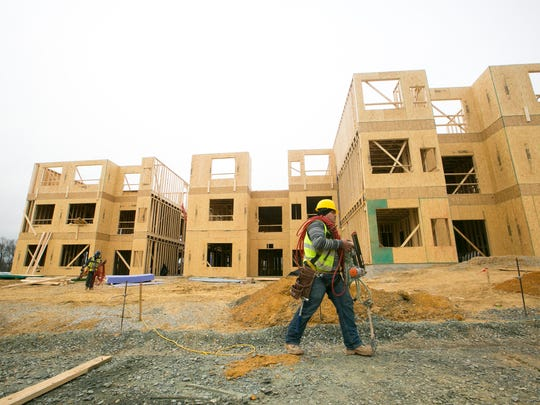 Construction work on apartments on Stanton Christiana Road near the Christiana Mall earlier this year. New Castle County Council is weighing tweaks to the rules that dictate new building.
