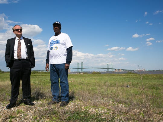 New Castle County Executive Tom Gordon (left) and Kimoko Harris, a longshoreman union official, stand on a proposed location for the new Port of Wilmington.