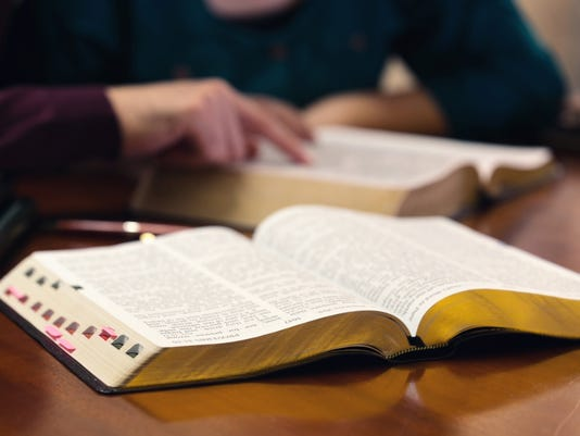 Young Couple Studying The Bible