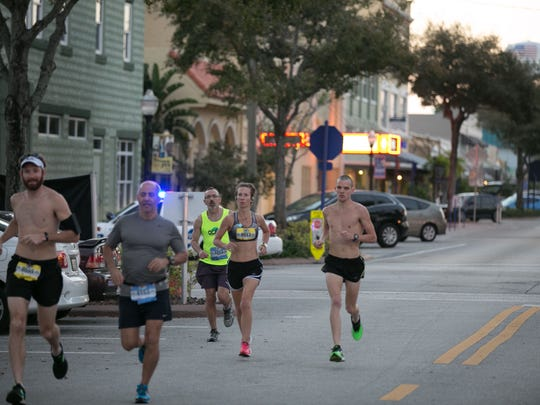 Marathon runners race through Downtown Stuart.