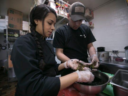 Nadia Holguin (left) and Armando Hernandez (right)