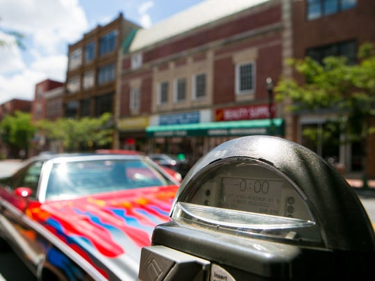 Time is expired on a parking meter along North Market Street in Wilmington where a vehicle was issued a violation.