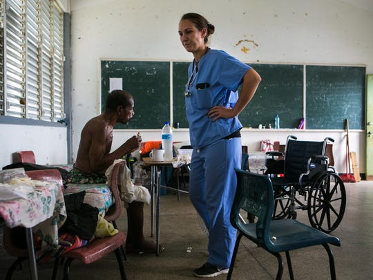 Nurse practitioner Lyndsay Bingnear helps a 73-year-old man in Portsmouth, Dominica, who hasn't had water in two days.
