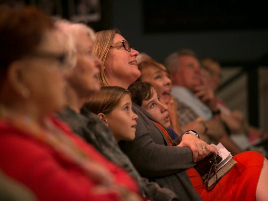 The audience listens to one of the stories told Wednesday night at the Alliance for the Arts during the Southwest Florida Storytellers event.