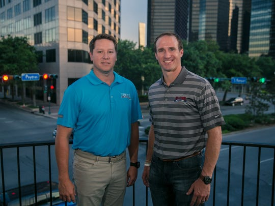 Brandon Landry, left, a former walk-on basketball player at LSU, and New Orleans Saints quarterback Drew Brees are co-owners of Walk-On's Bistreaux & Bar.