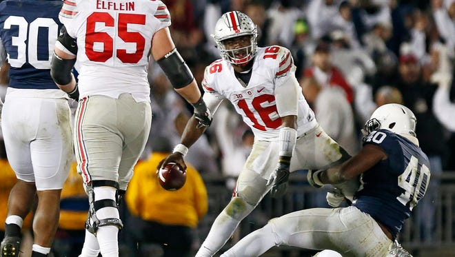 Ohio State quarterback J.T. Barrett is sacked by Penn State linebacker Jason Cabinda in the fourth quarter Saturday night.