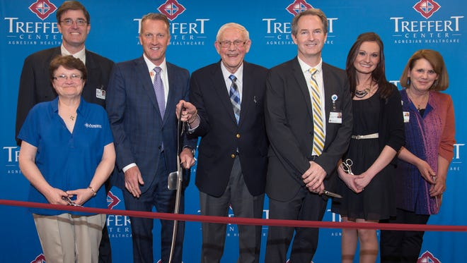 Agnesian HealthCare hosted a ribbon-cutting ceremony on April 7 for its new Treffert Center, located at 371 E. First St. Those helping open the new facility were (left to right): Vivian Hazel, Agnesian Beyond Boundaries of Autism (ABBA) supervisor; Tom Fabricius, MD, Treffert Center consulting services medical director; Steve Little, Agnesian HealthCare president & chief executive officer; Darold Treffert, MD, psychiatrist and world-renowned autism and savant syndrome expert, and Treffert Center research director; Matt Doll, PhD, Agnesian HealthCare Behavioral Health Services/Autism director; Leah Smit, Treffert Academy supervisor; and Joni Stine, Treffert Center librarian.