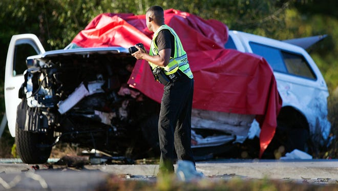 Florida Highway Patrol officers work the scene of a fatal accident on Lee Boulevard in Lehigh Acres on Friday. Multiple vehicles were involved in the accident.