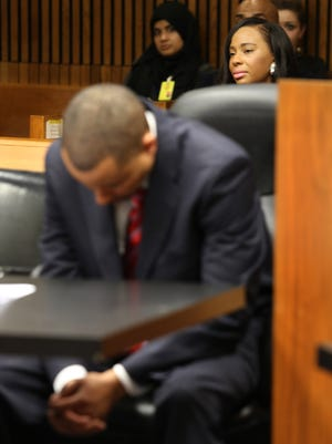 State senator Virgil Smith holds his head down in Judge Lawrence Talon's courtroom at the Frank Murphy Hall of Justice in Detroit on Monday, March14, 2016. Smith's ex-wife Anistia Thomas is seen behind.Smith will serve 10 months in jail with no early release and comply with psychiatric, alcohol and drug counseling, but does not have to give up his senate seat.Jessica J. Trevino/Detroit Free Press.