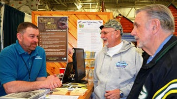 DNR Fisheries Biologist Ben Heussner discusses fishing with visitors to the Milwaukee Journal Sports Show.