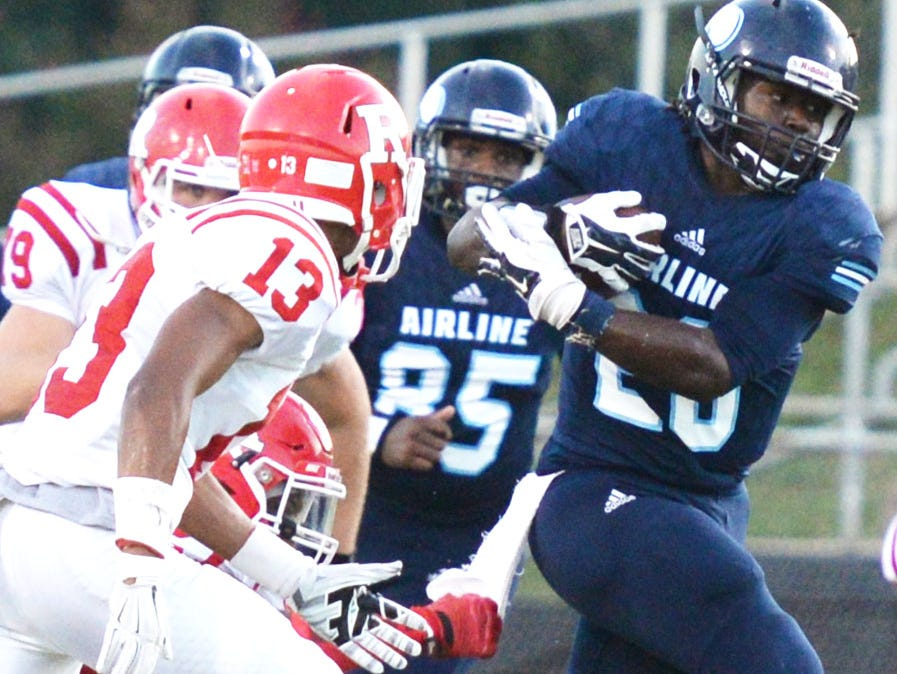 Airline's Gumarus Walker tries to get past Ruston's Friday evening at Airline High School.