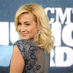 "FILE - In this June 10, 2015 file photo, Kellie Pickler arrives at the CMT Music Awards at Bridgestone Arena in Nashville, Tenn. Pickler is a veteran of reality television after honing her musical and dancing skills on ""American Idol"" and ""Dancing With the Stars,"" so she was very careful about agreeing to a new CMT reality show about her marriage to songwriter and producer Kyle Jacobs. (Photo by Sanford Myers/Invision/AP, File)"
