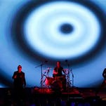 U2 performs during an announcement of new products by Apple on Sept. 9 in Cupertino, Calif.