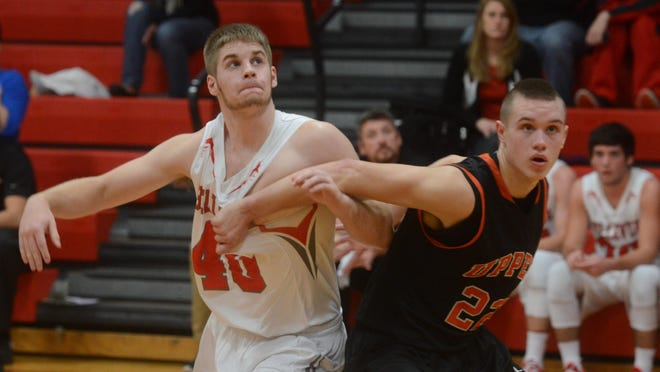 Bellevue's Shane Miller looks for a rebound as he is pressured by Upper Sandusky's Wes Vent during a basketball game on Thursday, Dec 11, 2014.