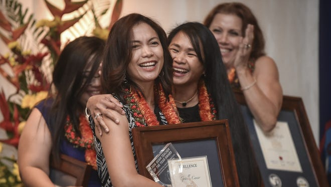 Gracelle Canar, teacher at Upi Elementary School, front, reacts to being named 2016 Guam Teacher of the Year at Hyatt Regency Guam on April 28.