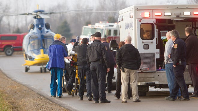 A gunman who shot himself after wounding another man is readied for transport by helicopter to an Ann Arbor hospital.