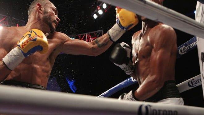 Jose Uzcategui throws a late punch against Andre Dirrell that knocked Dirrell out.