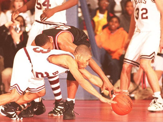 Red Bank's Milton Gray dives to the floor for a loose ball in the 1998 SCT final against Neptune.
