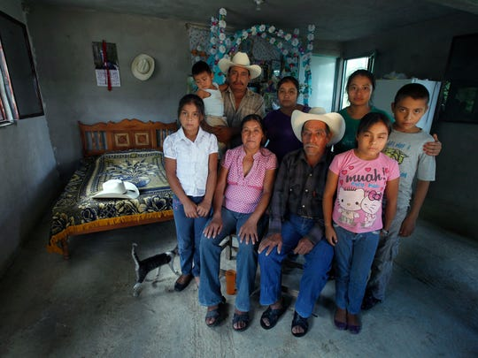 """In this July 15, 2016 photo, the parents and siblings of late Jose Rangel Chavez pose inside the new bedroom they built for him with the money he sent home from the U.S. as part of a guest worker program, in El Sabino, Mexico. Jose Rangel's father, Wenceslao Rangel Gutierrez, hobbled by untreated high blood pressure, can no longer provide for his family. """"He was our only option,"""" Jose's mother says of their oldest son. """"The only hope we had."""""""