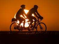 Riders start the day early outside Fort Dodge on the way to a breakfast stop in Duncombe Tuesday,July 21, 2015, during RAGBRAI XLIII.