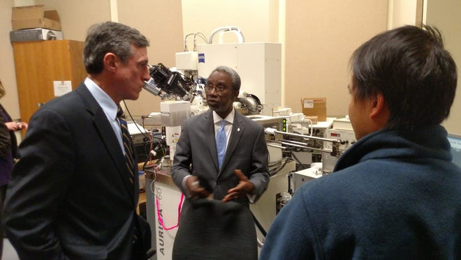 Babatunde Ogunnaike, dean of the College of Engineering at the University of Delaware, shows U.S. Rep. John Carney (left) the Interdisciplinary Science and Engineering laboratories at the school on Monday.