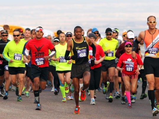 Runners start the 2014 Michelob Ultra El Paso Marathon atop Trans Mountain Drive.