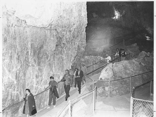 Visitors trek into Grand Canyon Caverns, circa the