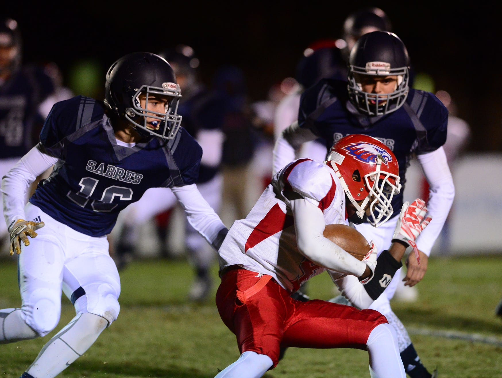 Southside Christian defense surround Wagener-Salley's Daniel Frazier (4) during a game at Southside Christian on Friday.