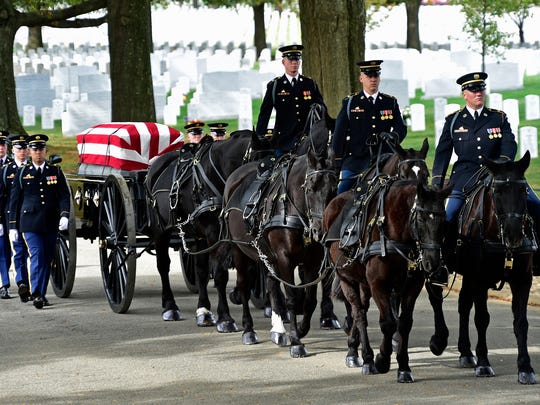 A caisson approaches the buriel site  on Oct. 26 during a funeral service for Cpl. Robert Meyers.