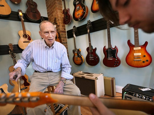 Glenn Snoddy, who invented the Fuzz Tone distortion pedal, listens to local artist Jesse Kramer play guitar, at Forrest York Guitars. Snoddy died May 21, 2018, at his home in Murfreesboro.
