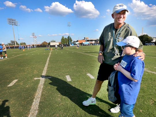 MTSU's head football Coach Rick Stockstill talks with Colton Sheets a young cancer survivor during practice on Thursday, Sept. 22, 2016, after giving Colton a backpack filled with MTSU items. Colton will be MTSU's honorary Captain for the home game against Louisiana Tech, this Saturday.
