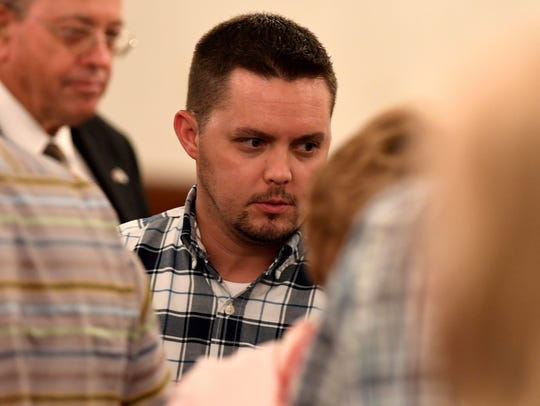 Clint Bobo walks out of the courtroom during an afternoon