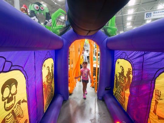Isabelle Melbert, 5, takes a peek inside an inflatable