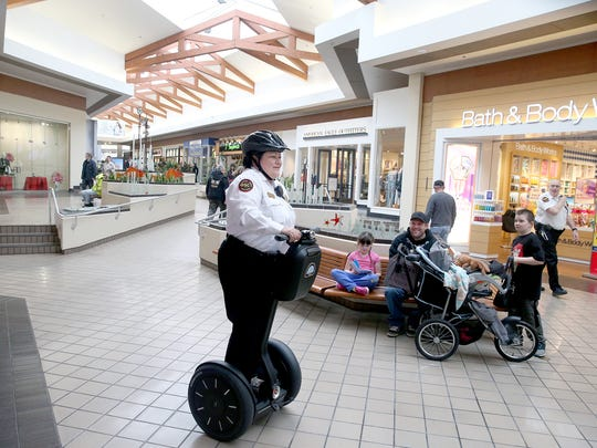Security supervisor Ana Hernandez makes her rounds on a Segway inside the Kitsap Mall in SIlverdale.