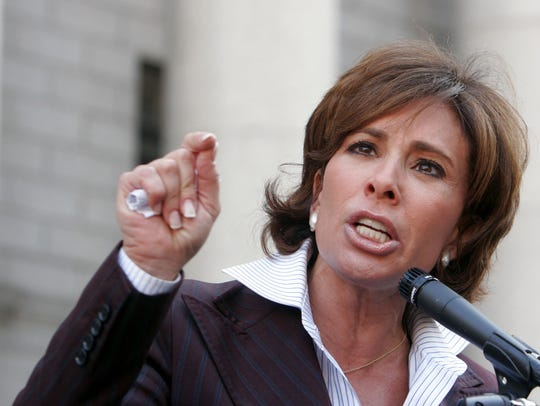Jeanine Pirro holds a news conference in front of the