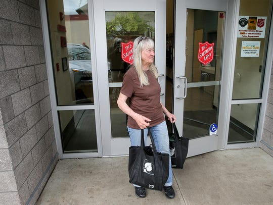 Cynthia Duval, a winter shelter resident at the Salvation Army in Bremerton, leaves to go to the Seattle ferry on Friday.