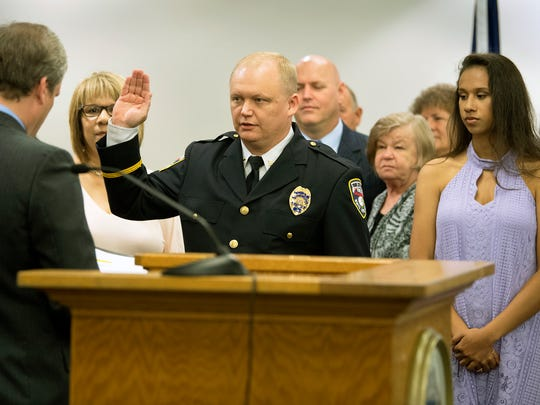 Troy Bankert is sworn in as chief of police in York during a ceremony at City Hall in York Monday.
