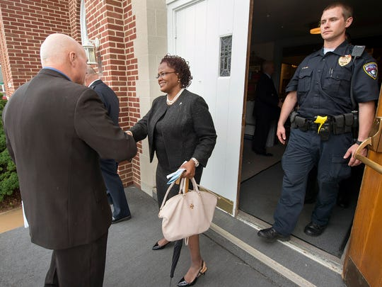 York Mayor C. Kim Bracey, who is running for re-election, shakes hands with retired York City police captain Bruce Veseth, left, after leaving the annual Police Memorial Service at Faith United Church of Christ in York.