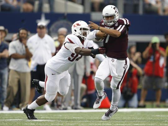 Arkansas' Taiwan Johnson stops Texas A&M quarterback