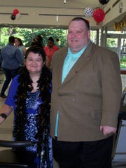 CAU members Myrta Rosa and Gary Rubin attend the 11th annual CAU Community Prom last week at the Peterstown Community Center in Elizabeth.