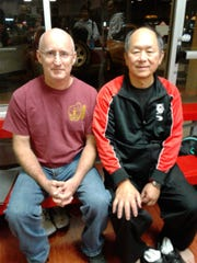 Yang Jwing-Ming (middle) with Academy of Asian Martial Arts owner Paul Bystedt during a seminar in Houston.