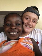 Delta golfer Joseph Tempest with a friend in Liberia.