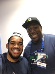Karl-Anthony Towns takes a selfie with his dad Karl on Thursday.