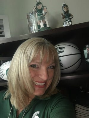 Amy McGraw is president of the 2,600-member South Florida Spartans alumni group. She considered quitting after hearing the statements of survivors of Larry Nassar. Now she wants to be part of the solution.