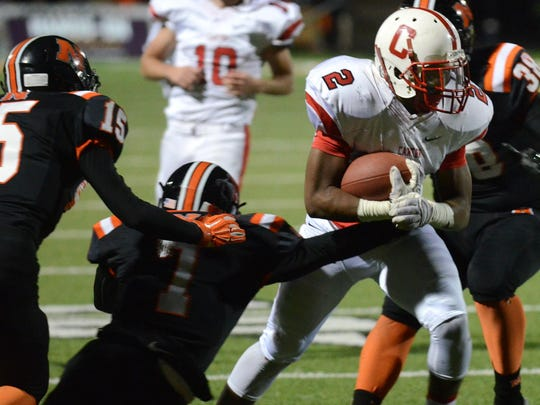 Canton's Markus Sanders (right) picks up some yards