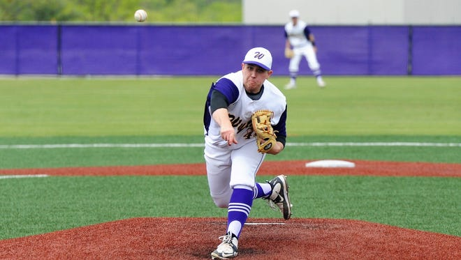 Wylie pitcher Blake Smith (45) lets go of a pitch during the Bulldogs' 6-2 win against Brownwood at Bulldog Field on Friday, April 20, 2018. Smith retired the first 19 batters in order, pitching a perfect game through one out in the seventh.