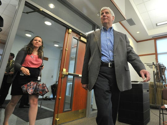Michigan Gov. Rick Snyder arrives at the Superior Township offices to vote on Proposal 1 in Superior Township on Tuesday