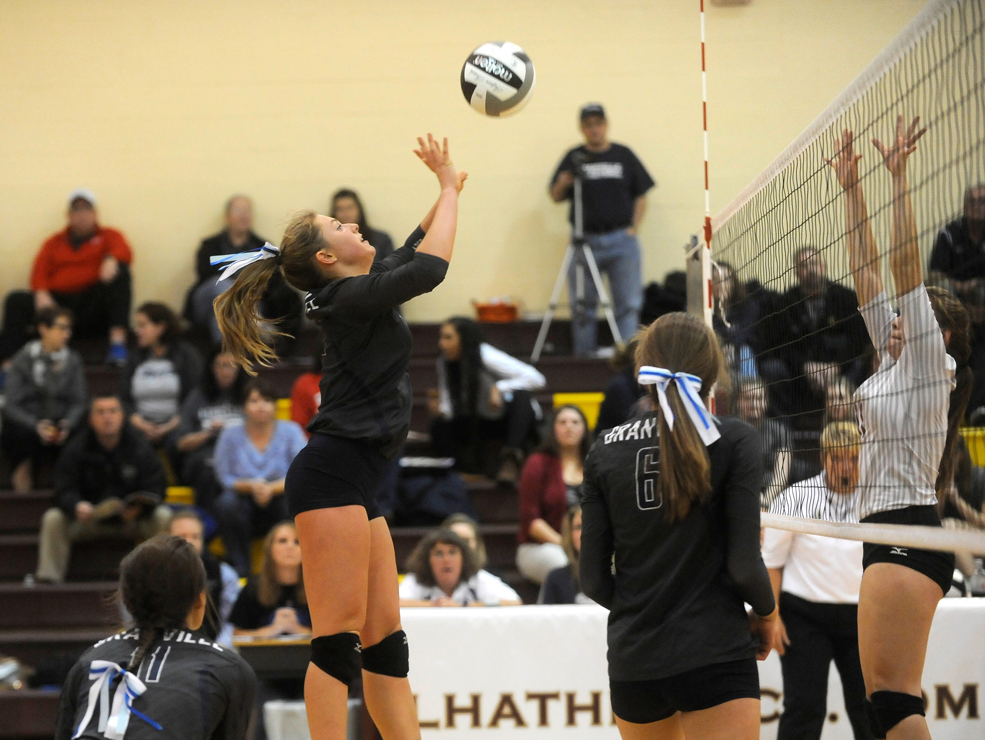 Granville's Christina Harrison sends the ball at Lakewood during a Division II district semifinal on Thursday, Oct. 29, 2015, at Licking Heights. The Blue Aces defeated the Lancers 3-1 and will advance to play Bishop Hartley in the district finals at 1 p.m. on Saturday at Licking Heights.