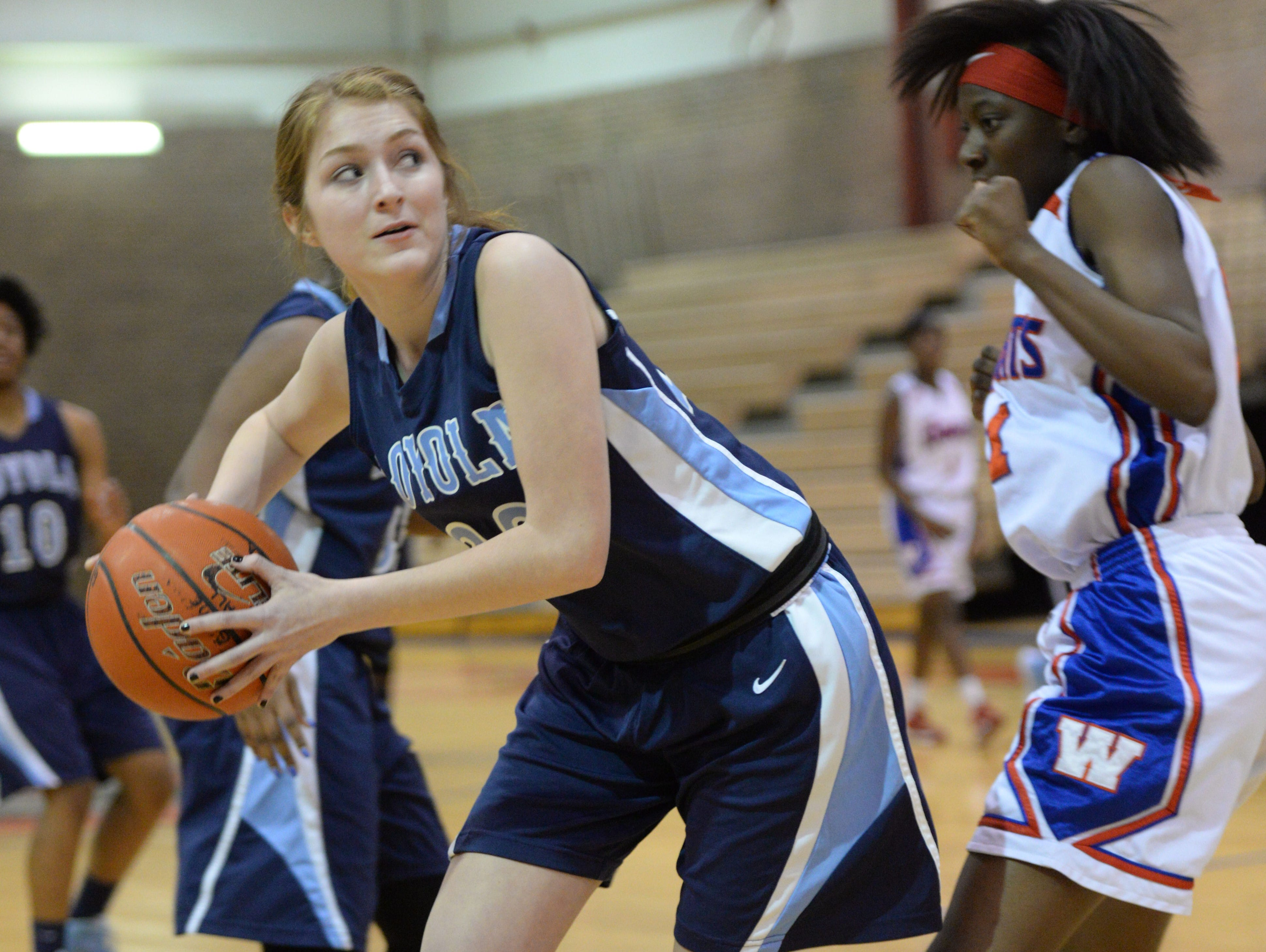 Loyola's Katherine Jones spins for the bucket on Friday night against Woodlawn.